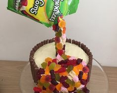 How to make a gravity defying cake with sweets pouring out of thin air! A treat filled cake that kids will love.