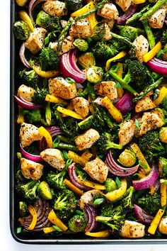 """This delicious Sheet Pan Chicken and Veggies """"Stir Fry"""" dinner recipe is quick and easy to prepare, and made with a delicious sesame-soy dressing that everyone will love. Plus, it's easy to make-ahead and refrigerate if you'd like to do some meal planning for the week!   gimmesomeoven.com"""