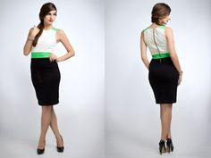 This 3-tone pencil dress is extremely slimming. The fresh green gives a nice pop to the structured black and white pencil dress. This dress is fully