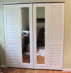 A combination of Plantation louvered doors and mirror doors are used to make up these bifold closet doors.