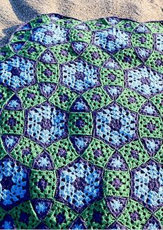Grow Your Molecule blanket consists of three types of motifs: hexagons, triangles and traditional granny squares. The motifs are joined as you go, making for minimal finishing.