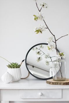 signs of sping inside - lovely vase and branch with blossoms