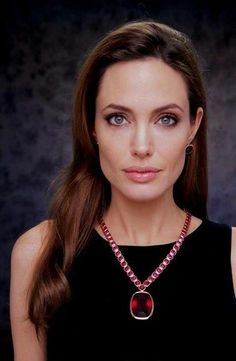 angelina Jolie - is wearing rubies and rubies represent prostitution.