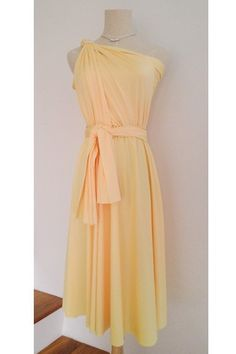 Canary Yellow Mini Convertible Wrap Dress can be wore in more than 20 styles and fits many different body types easily. Ideal for bridesmaid dress and other formal occasions too.