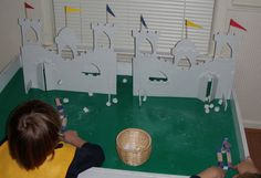 Maybe with Pirate ships and marshmallows for SonTreasure Island VBS???  Crack of Dawn Crafts: Knight Party: Storm the Castle Catapult Game