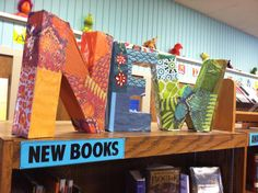 """""""NEW letters in the library! Modpodge and origami paper. #iowatl"""""""