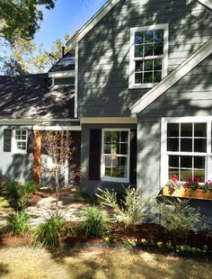 Exterior: SW Grizzle Gray w/ SW Pure White trim. Black shutters...cedar window boxes and cedar porch pillars