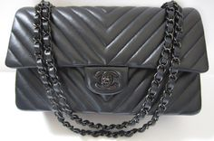 **NEW CHANEL CLASSIC MEDIUM-LARGE ALL BLACK CHEVRON 11.12** From the New Colection Printemps-Été 2015. NEVER WORN. Sold-Out everywhere! Bought at Chanel Brussel in March 2015. Complete, with Box, Dust bag, Authenticty Card, Chanel Paper Bag with camelia and Original Receipt. Still with protective adhesive. I can send more pictures with all details if you wish. Price - 4.450€
