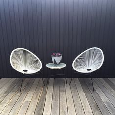 An oldie but a goodie; this greyed off grey ironbark decking looks ace with a contrasting dark wall and a couple o' Acapulco chairs. All that's missing is a tropical cocktail and a good book. Nice work as always, Made in Melbourne, supplied to Australia. Outdoor Rooms, Outdoor Tables, Outdoor Decor, Front Verandah, Acapulco Chair, Modern Courtyard, Timber Deck, Exterior Cladding, Deck With Pergola