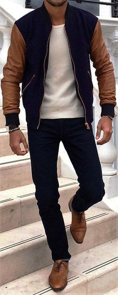 Very good use of muted colors. Notice how the jacket matches the jeans and boots. Good job.