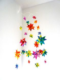 Modern Baby Mobile Hanging Origami Stars by theStarcraft on Etsy.   I definitely prefer bold colors for babies!