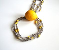 linen and wooden beads..from a shop on Etsy that has a lot of neat items ($20, dekkoline, Etsy)