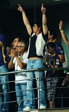 Bollywood film actor and co-owner of Kolkata Knight Riders team Shah Rukh Khan (5R) celebrates during the IPL Twenty20 cricket match between Kolkata Knight Riders and Chennai Super Kings at The Eden Gardens in Kolkata on May 14, 2012.
