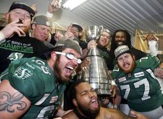 Members of the Saskatchewan Roughriders celebrate their Grey Cup victory (Mark Blinch/Reuters)