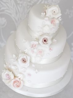 Avondale Wedding Cake Pretty and vintage, finished with sugar blossoms and roses in soft blush tones and white.