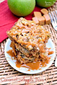These Caramel Apple Bars are loaded with fresh apples, caramel, walnuts, and shredded coconut and baked to ooey gooey perfection! A delicious taste of fall! #fall #apples #desserts #recipes #ladybehindthecurtain