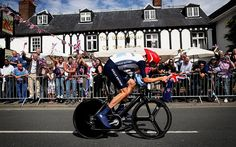 LONDON, ENGLAND - AUGUST 01: Bradley Wiggins of Great Britain cycles past a pub in Esher during the Men's Individual Time Trial Road Cycling