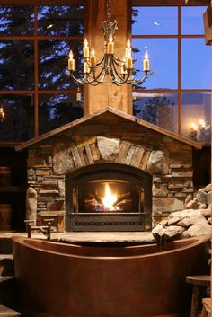 Another beautiful fireplace. LOVE the large windows too. As long as I'm in the country and have NO NEIGHBORS to peer in. LOL