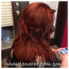 Fabulous long red hair with hilites and lolites. Rock star layers. Love this hair!