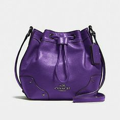"""NWT Coach Purple Baby Mickie Drawstring Bag NWT Coach Baby Mickie Drawstring Bucket Bag/Purse in Purple. Gorgeous color and soft leather.  Comes with original foam packaging and plastic bag.  Has a zipper compartment inside with 2 multifunction pockets. Approximately 8.5"""" L x 8"""" H x 4"""" W with an adjustable strap drop of 20.5 - 25"""" Coach Bags"""