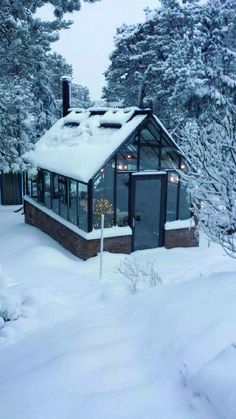 Snow and cold in northern Sweden. Inside the double glass Cape Cod Orangery it is 20 degrees above zero when the fire is crackling in the stove. http://garden-greenhouse.se/