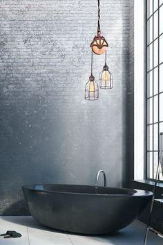 A black bath tub, stunning.