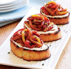 Goat cheese speckled with fresh thyme is the perfect creamy counterpoint to the sweet, tangy roasted peppers in this recipe. Serve these crostini as an appetizer or paired with a simple green salad for a light lunch.
