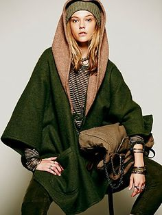 Cult Of Beauty Hooded Cloak by Free People | This hooded wool cloak features a contrast color hood, two deep patch pockets, and a toggle closure.