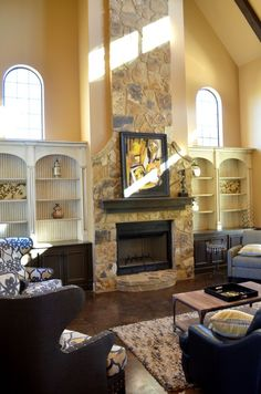 Antiqued built-ins with stone fireplace