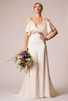 This   Temperley London   gown is rendered in silk and features a draped  bodice with a v-neckline dae2718d9b5c