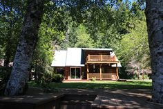 Lakefront log home on Fishhawk Lake listed and sold by Gayle Rich-Boxman