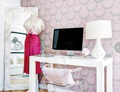 feminine office: off-white mirror, a dress on display, sleek white desk & lamp, ghost Louis chair, statement wallpaper