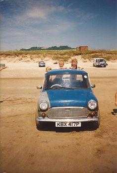 mini pick-up full of kids on the beach
