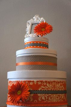 Orange & Grey Diaper Cake Make it out off hat boxes and fill will anything. Great idea