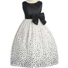 Flower girl dress in black and white. Instead of dots, black appliqué instead. Instead of the black bow, should be big satin flower.