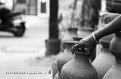 An old lady selling clay water pots at old city... By Rakesh Krishnotula Follow on IG : rakesh.krishnotula Production : volume.asia