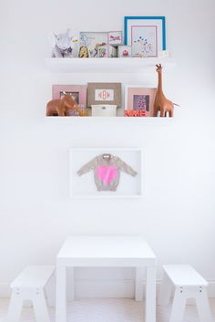 A simple, chic play space featuring our Hippo and Giraffe Menagerie Bookends, by @GreyLikesBaby. #serenaandlily