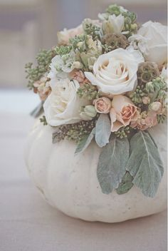 Pumpkins as vases for centerpieces - I know there's a lot of white in here, but you can change any of it to incorporate your colors!