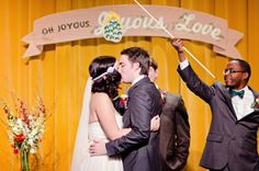 A Christmas wedding isn't complete without a smooch under the mistletoe! // photo by MatthewMoorePhotography.com