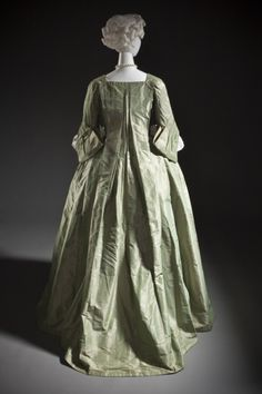 Back view, robe a la Française, Europe, c. 1725. Green silk taffeta, stomacher embroidered with floral motifs in multicoloured silk threads.