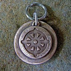 buddhist dharma wheel dog tag: This is a beautiful solid bronze customized dog tag of the Buddhist Dharma Wheel.