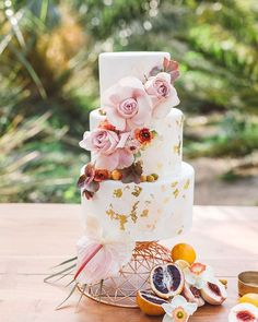 Fondant cake with gold leaf detail decorated with roses ~ we ❤ this! moncheribridals.com
