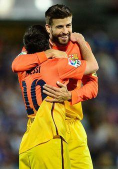 Gerard Pique and Leo Messi