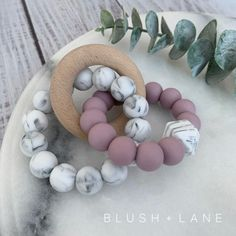 The Quinn tri-teether has two silicone rings and one wooden ring that creates a great teether for achy gums and also acts as a sensory toy for babies. Diy Teething Toys, Baby Diy Projects, Nifty Crafts, Kids Headbands, Dummy Clips, Baby Teethers, Sell Diy, Baby Rattle, Diy Toys