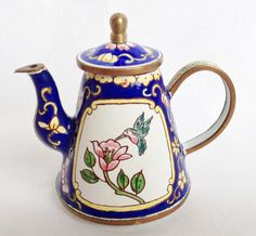 Colourful Hummingbird with flower teapot by Charlotte di Vita; miniature enamel teapots from nivagcollectables.co.uk