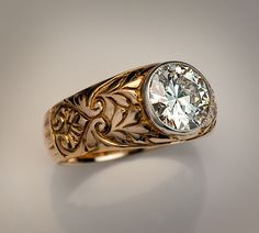 A Vintage Russian Diamond Ring made in Moscow between 1908 and 1917. A 14K gold ring features a sparkling old European cut diamond set in a silver milgrain