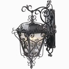 Wrought iron wall decor is durable, intricate, beautiful, can be displayed properly in almost every decorating theme, and never goes out of style. Wrought iron decor antiques are treasured from all over the World - especially candle lanterns, sconces, stands, wall art, and chandeliers.    Hang your wrought iron proudly, and if you have a wrought iron weakness like I do, here's a few new designs to add to your collection... :-)