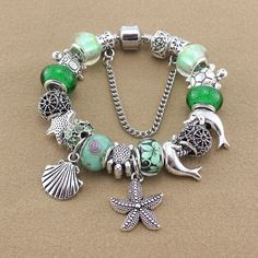 GREEN SEA TURTLE BRACELET/DOLPHIN/STARFISH.  I think this would make a nice anklet for a beach wedding, too.