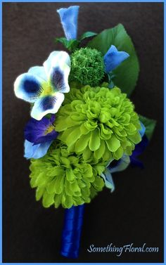 Blue, green, purple, and white groom's boutonniere, designed by Something Floral / Something Spectacular, featuring button chrysanthemums and miniature pansies.