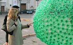 On December 4, 2012, Kaunas, Lithuania unveiled a 42 foot tall Christmas tree made of 32,000 green plastic bottles. At night, the tree is lit by 40,000 lights. The tree is by Lithuanian artist Jolanta Smidtiene.